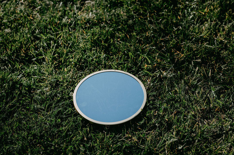 High angle view of sunglasses on field