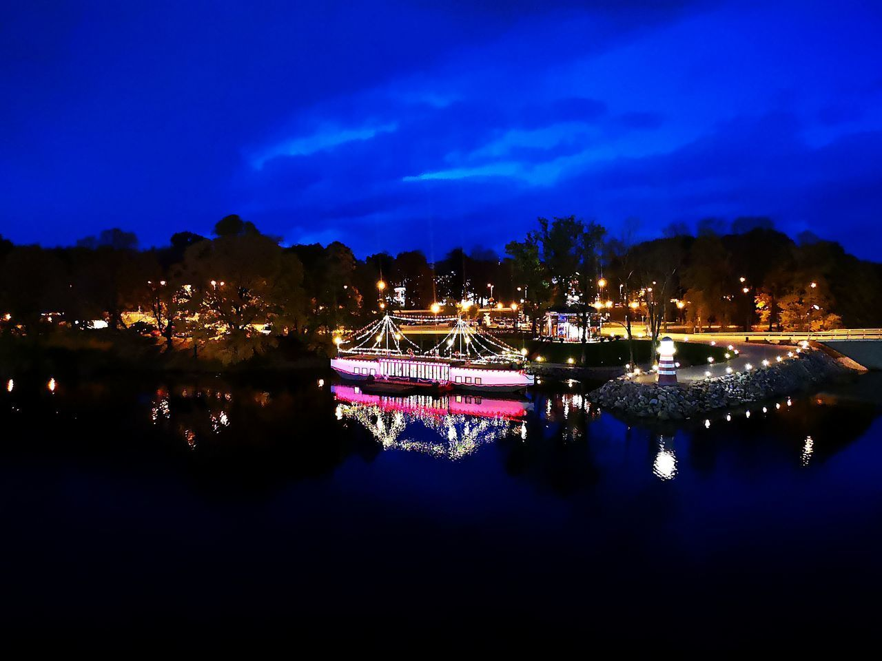 illuminated, water, night, reflection, sky, no people, waterfront, building exterior, architecture, nature, built structure, city, blue, river, tree, glowing, cloud - sky, nautical vessel, outdoors, purple