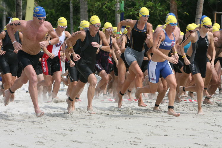 Athletes running at beach