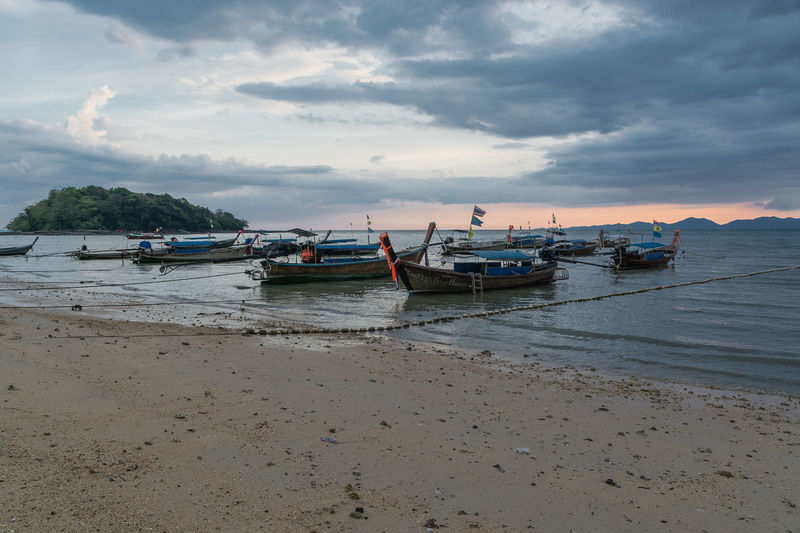 Krabi Krabi Thailand Anchored Beach Beauty In Nature Cloud - Sky Day Fishing Boat Land Low Tide Mode Of Transportation Moored Nature Nautical Vessel No People Non-urban Scene Sand Scenics - Nature Sea Sky Tranquil Scene Tranquility Transportation Water