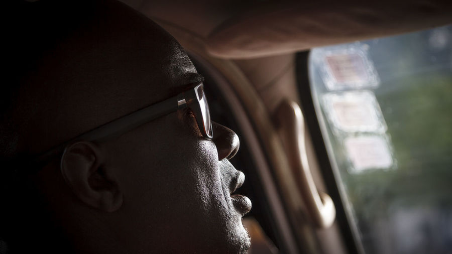 Fresh On Eyeem  Senegal, Mode Of Transport Taxi Driver Journey, Headshot Natural Light Portrait Car, Close-up Alone, Auto, Sunlight, Shades And Shadows Shadow,sillouette Driving, Sunglasses, Profile, Behind The Wheel, Black, On The Way Dark, Man, Selective Focus African, MeinAutomoment Feel The Journey