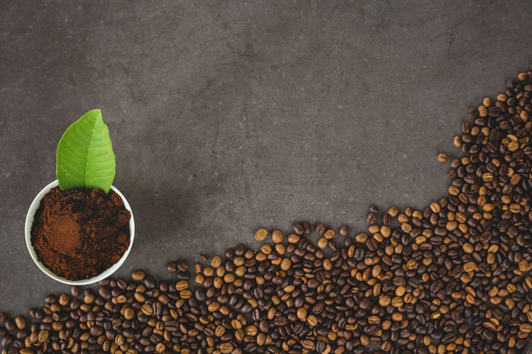 Coffee cup and coffee beans , flat lay image with copy space for your text Food And Drink Food Freshness Coffee - Drink Roasted Coffee Bean Coffee Large Group Of Objects No People Indoors  Drink Seed Abundance Roasted Brown Still Life Spice Copy Space Table Black Color Heap Caffeine