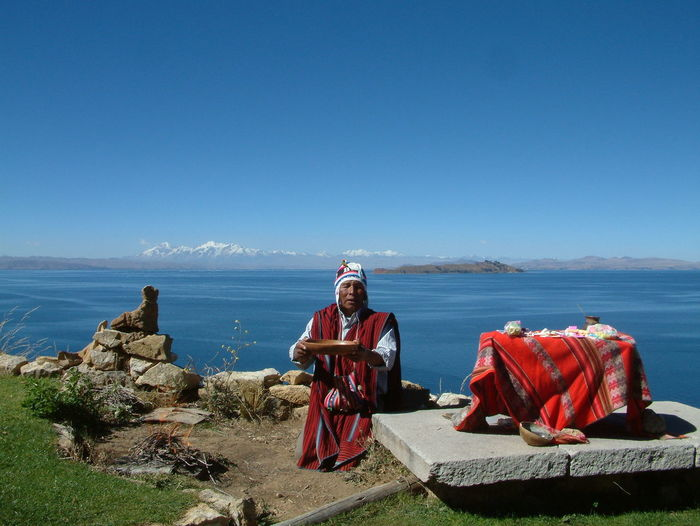 Inka shaman on the Isla del Sol, Lake Titicaca Adult Adults Only Beauty In Nature Blue Bolivia Clear Sky Day Horizon Over Water Inka Isla Del Sol Lake Titicaca Nature Outdoors People Real People Scenics Sea Senior Adult Shaman Sitting Sky Titicaca Traditional Clothing Water EyeEmNewHere Neighborhood Map