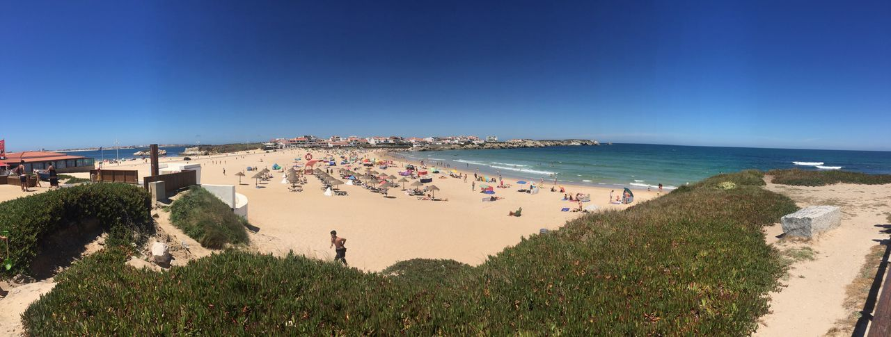 Sea Beach Large Group Of People Real People Clear Sky Blue Vacations Water Leisure Activity Nature Outdoors High Angle View Sunlight Sand Horizon Over Water Day Men Beauty In Nature Built Structure Scenics Portugal Baleal 2017