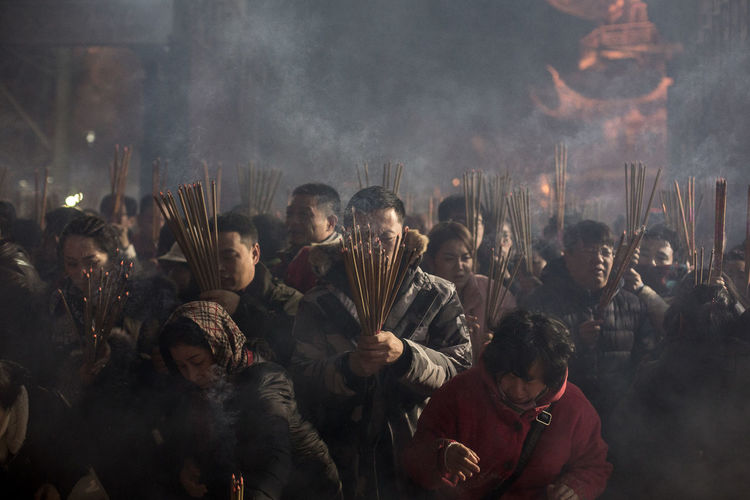 Celebration of the year of the Pig in Longhua Temple, the most ancient Buddhist Temple in Shanghai (built in 272 A.D. during the Song dinasty). Group Of People Crowd Religion Spirituality Smoke Real People Buddhism Longua Temple Temple Chinese New Year Incense Incense Sticks Burning Incense Faith China Shanghai Chinese New Year 2019 Buddhist Temple