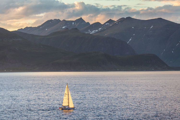 Adventure Club Arctic Beauty In Nature Boat Cloud Cloud - Sky Idyllic Midnight Sun Mode Of Transport Mountain Mountain Range Nature Nautical Vessel No People Northern Norway Norway Outdoors Remote Sailboat Sailing Scenics Sky Tranquil Scene Tranquility Water