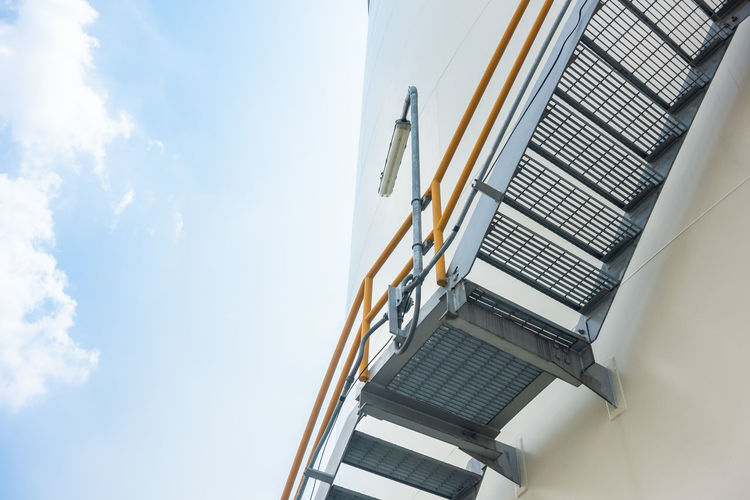 Architecture Building Exterior Built Structure Chair Cloud - Sky Day Ladder Low Angle View Metal Nature No People Outdoors Railing Seat Sky Staircase Steps And Staircases Sunlight Technology Wall - Building Feature
