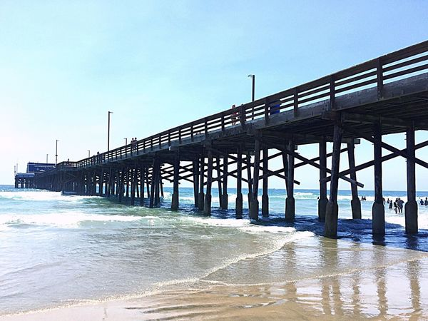 Beachlife Built Structure Architecture Water Beach Pier Clear Sky Sea SUPPORT Silhouette Sand Shore Nature Day In A Row Repetition Beachphotography Blue Wave Architectural Column Scenics No People