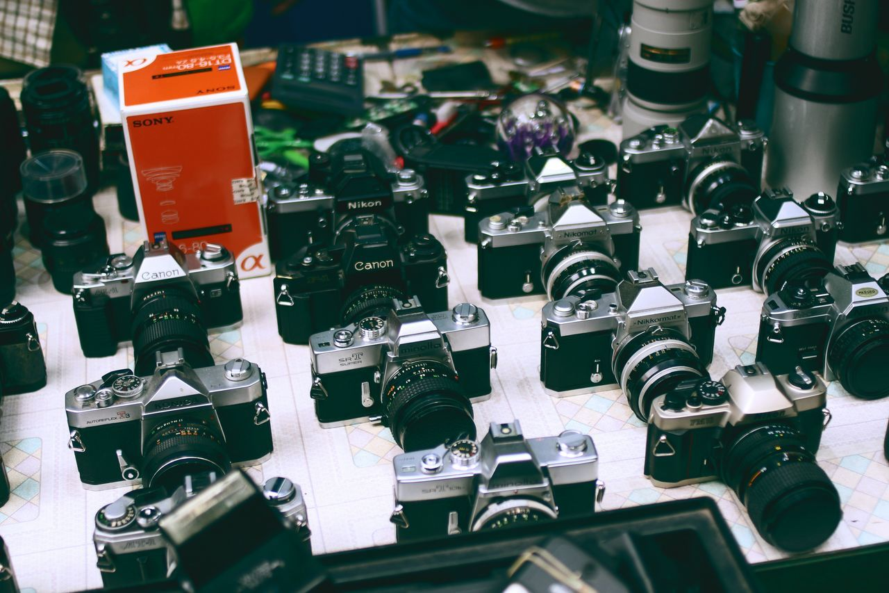 High angle view of cameras on display at store