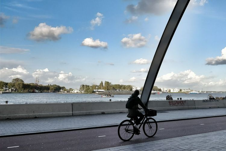 Bicycle Cloud - Sky Sky Transportation Mode Of Transport Day Cycling City One Person Outdoors Taking Photos ❤ EyeEm