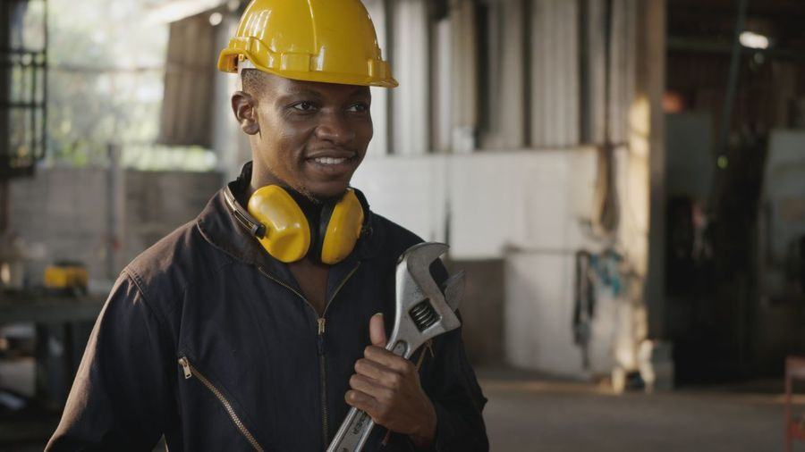 Portrait of smiling man working
