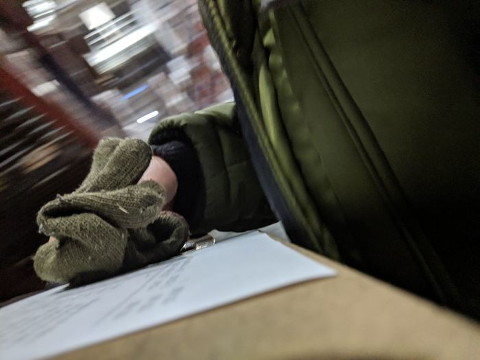 Indoors  One Person Selective Focus Table Publication Furniture Focus On Foreground Book Paper Winter Human Body Part Hand Textile Close-up Human Hand Day Warm Clothing Clipboard