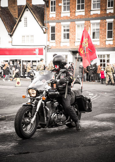 Hells Angel biker taking part in the 2017 Bicester Remembrance Day Parade Harley Davidson Remembrance Day 2017 Remembrance Day Parade Architecture Bicester Biker Building Exterior Built Structure Day Flag Flags Headwear Hells Angel Land Vehicle Large Group Of People Market Square Men Mode Of Transport Motorbike Motorcycle Outdoors People Real People Rememberance Transportation