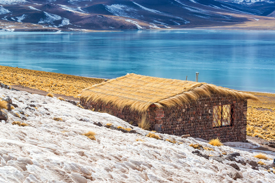 Rustic house and blue, frozen Lake Miscanti near San Pedro de Atacama in Chile Altiplano Andean Atacama Atacama Desert Chile Colorful Desert Frozen High House Lagoon Lake Landscape Miscanti Miscanti Lake Mountains Nature Red Rustic Salt San Pedro De Atacama Sand South America Tourism Volcano