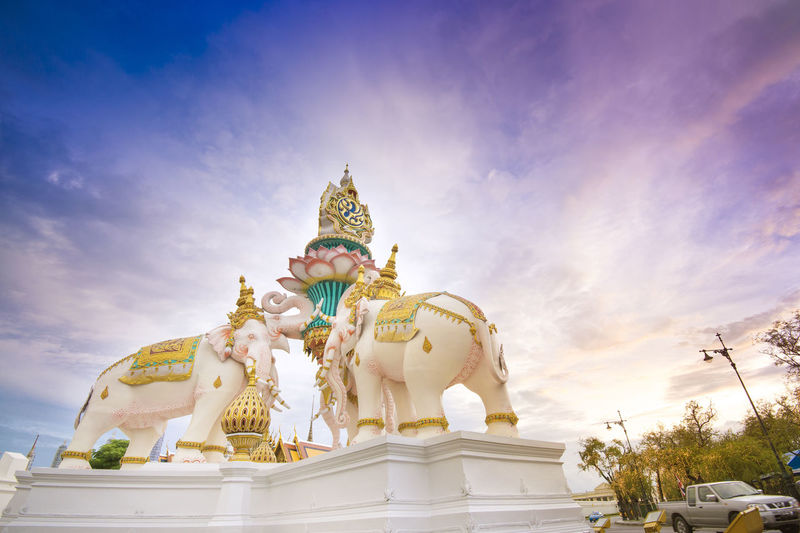 Low Angle View Of Statues At Wat Phra Kaew Against Sky