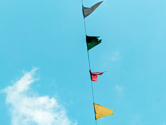 Low angle view of flags flag against sky