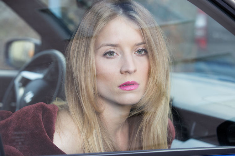 Headshot Portrait Transportation Mode Of Transportation Car Motor Vehicle Young Adult Travel Hair Land Vehicle Young Women One Person Vehicle Interior Front View Blond Hair Window Beauty Real People Day Beautiful Woman Hairstyle Contemplation