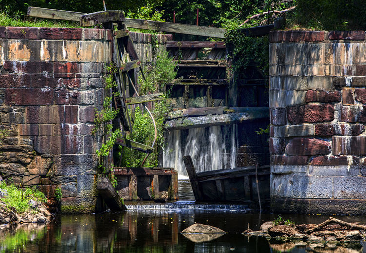 From times past Canal Lock Gate Ruins Abandoned Ancient Architecture Architecture Building Exterior Built Structure Canal Cascading Water Falls Falling Water Lake Leaking Water Lock Gates Nature Obsolete Old Old Brickwork Wall Water Wood - Material