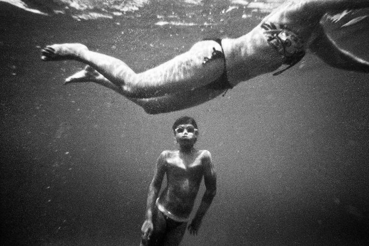 Art Black And White Blackandwhite Blackandwhite Photography Bonding Boys Casual Clothing Childhood Elementary Age Fine Art Photography Full Length Fun High Angle View Holding Leisure Activity Lifestyles Men Mid Adult Men Nikos Pandazaras Person Street Streetphotography Togetherness Underwater Young Men