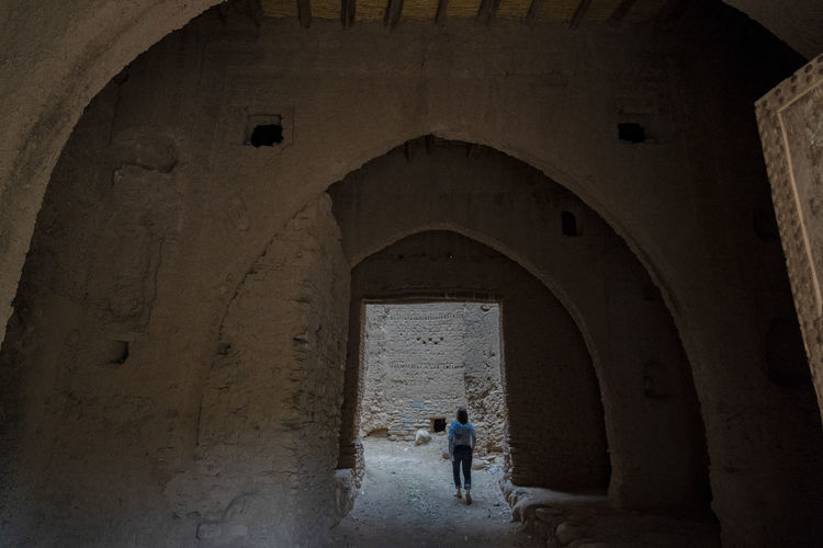 Architecture Arch History The Past One Person Indoors  Building Old Abandoned Damaged Ancient Rear View Deterioration Full Length Ancient Civilization Ruined Casbah Castle North Africa Middle East Haunting  Archway Ruins Red Brick Woman