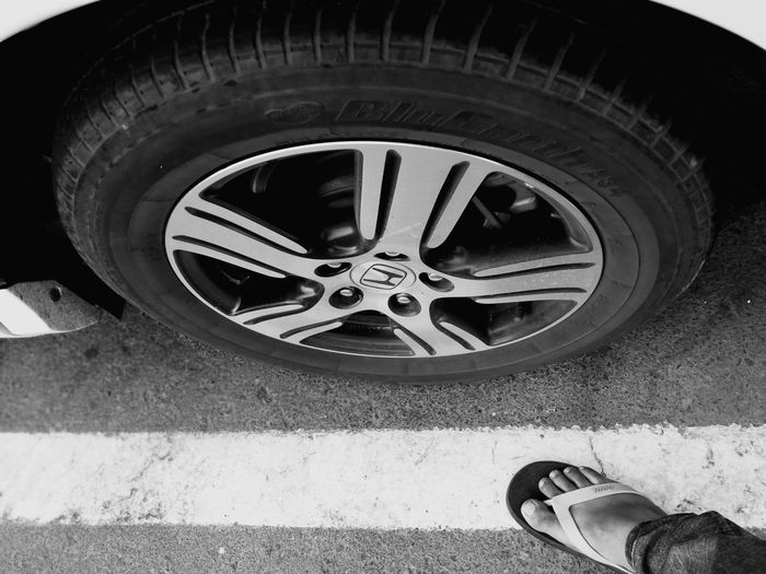Tire Wheel Low Section High Angle View Lifestyles One Person Outdoors Adults Only Real People Only Men Honda