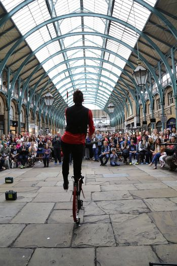 Artist Covent Garden  EyeEm LOST IN London Architecture Artistic Expression Bicycle Crowd Indoors  Large Group Of People Men Real People Streetphotography Transportation Travel