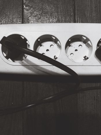 white power sockets and cords Close-up Indoors  Power Source Power Socket Power Cable Power Supply Power Line  Top Perspective High Angle View Close Up Technology Black And White Everyday Objects Top View