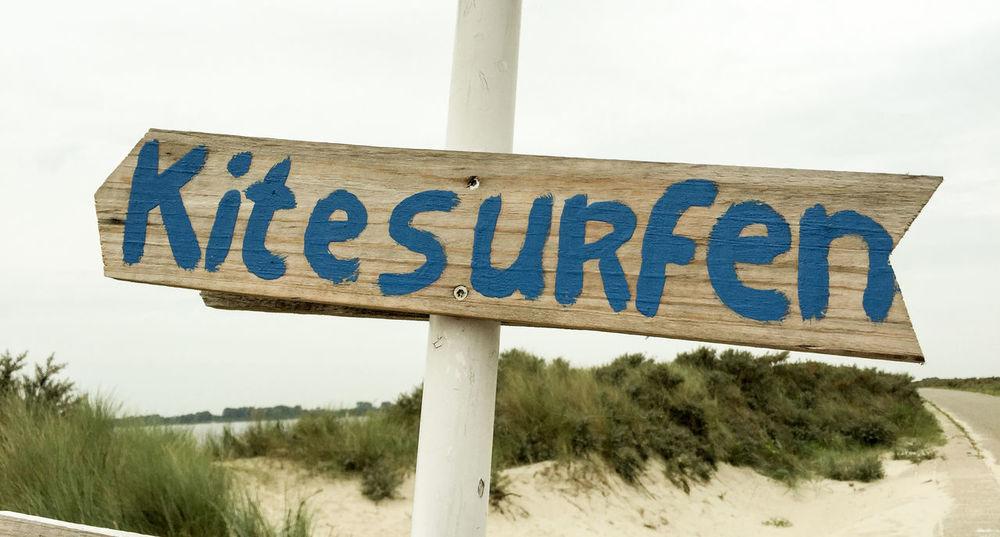 Sign showing the term Kitesurfen Beach Beach Photography Beach Sports Kitesurfen Kitesurfing Sign Signpost Sports