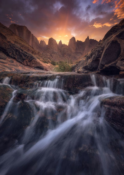 Great mountains with waterfalls Beauty In Nature Scenics - Nature Mountain Sky Non-urban Scene Tranquil Scene Rock Water Tranquility Mountain Range Sunset Nature Environment No People Rock - Object Idyllic Solid Motion Flowing Water Outdoors Formation Flowing Eroded