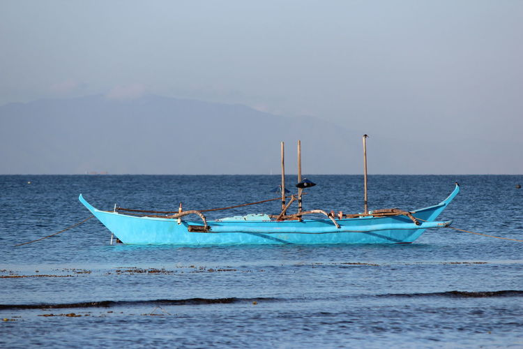 Blue boat in ocean blue Boat Small Boat Blue Boat Ocean Sea Philippines Batangas Batangas,philippines Water Water Transportation Fishing Boat Nature Horizon Blue Transportation Beauty In Nature