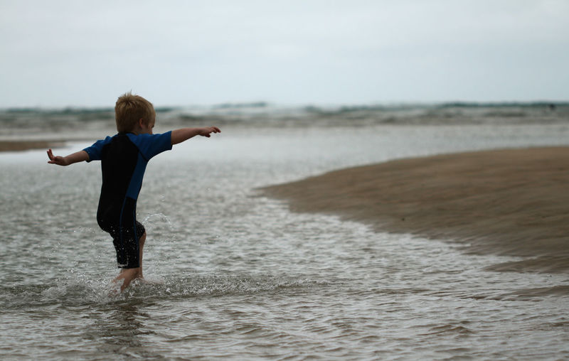 Boy Running At Beach