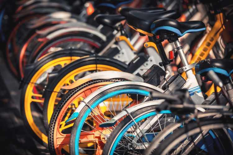 Close-up of bicycles parked in row