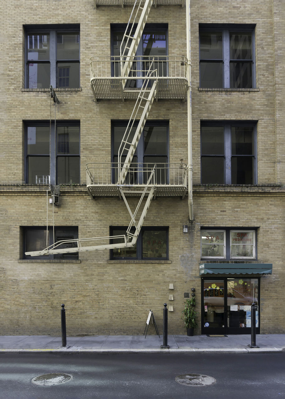 architecture, building exterior, built structure, fire escape, steps, steps and staircases, staircase, window, railing, outdoors, urgency, day, no people