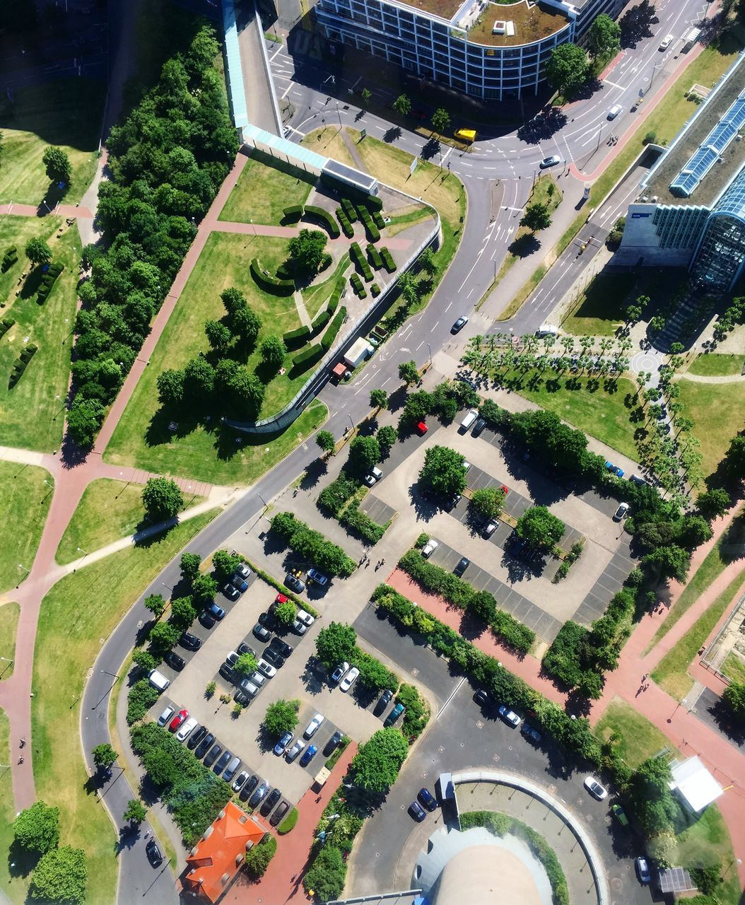 high angle view, road, tree, aerial view, architecture, transportation, building exterior, built structure, connection, car, day, street, city, land vehicle, outdoors, no people, water