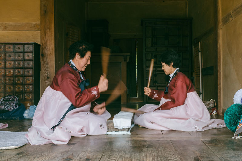 Ironing clothes in a traditional way Asian  Asian Culture Bat EyeEm Best Edits Fashion Hanbok Ironing Korean Lifestyles Open Edit Person Sitting Team Teamwork Tradition Traditional Women