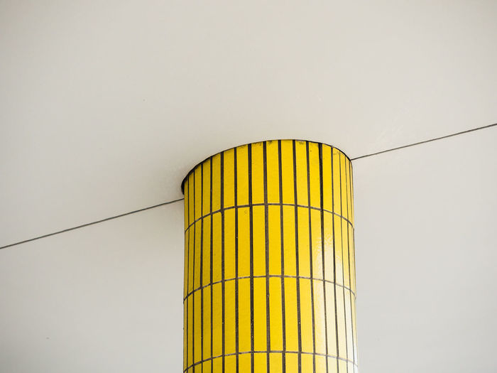 Low angle view of yellow pillar