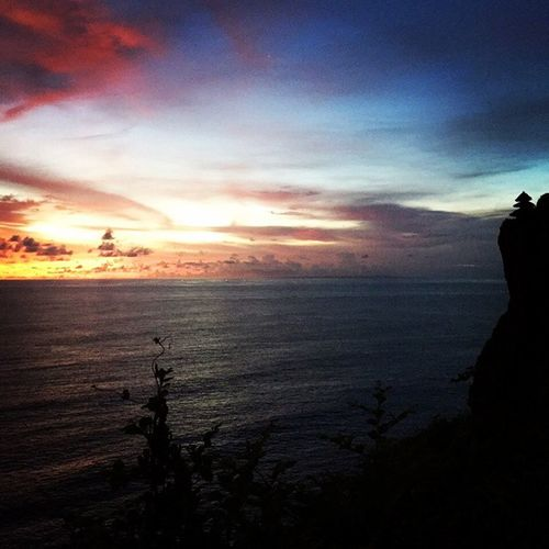 Uluwatu's horizon.. Bali Nyepi Solitude Solitaire LandOfGods Sunset Horizon Beach Beautiful Sky Colourful Rainbow Pura Rocks Temple Clouds Twilight Fading Light Sea Nature BaliExotic Travel LovelyIndonesia