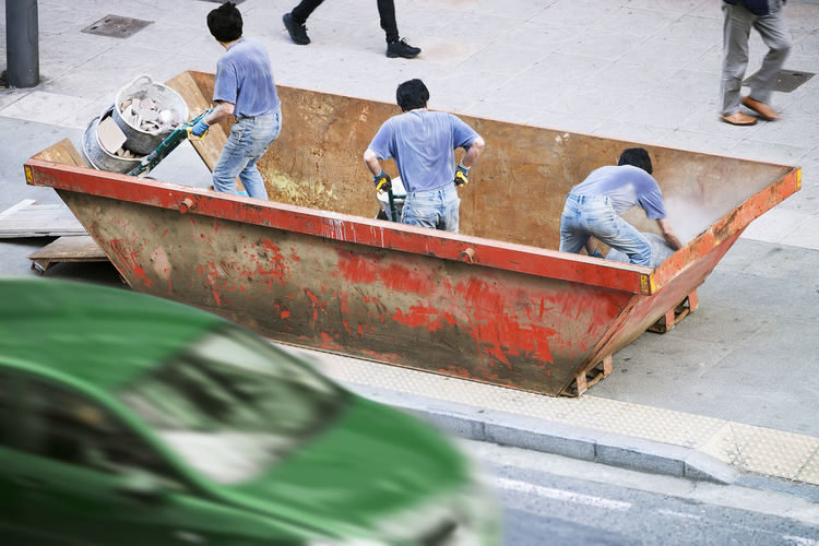 Rear View Of Workers Working On Street