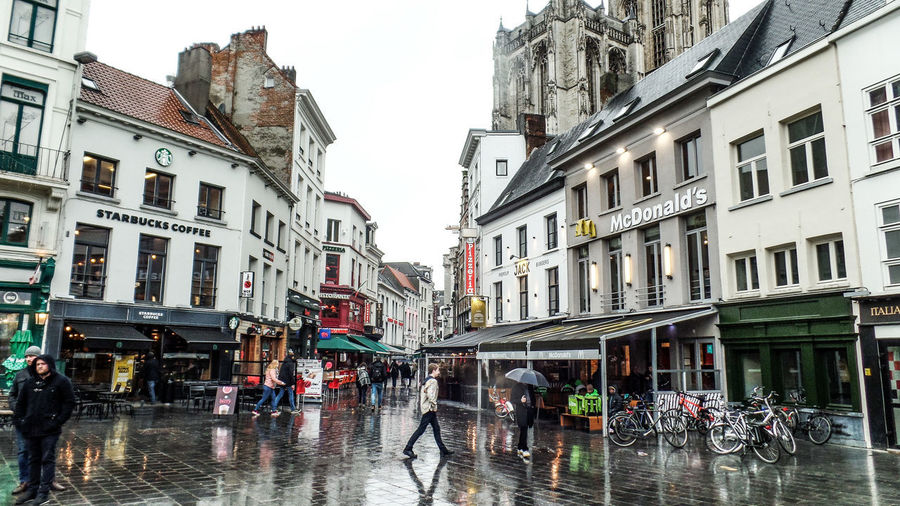 Building Exterior Architecture City Built Structure Street Wet Group Of People Rain Building Real People City Life Women Nature Water Window Day Transportation Men City Street Rainy Season Outdoors