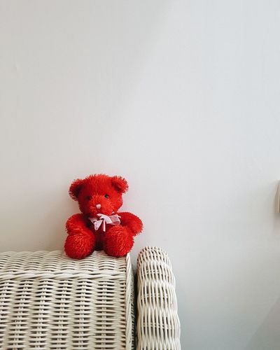 red teddy bear on a bed post Cute Animal Dolls Bed Post Background Teddy Bear Doll Object White Background Red Bear Red Teddy Bear Red Doll Cuddly Bear Soft Contrast Basket Red No People Indoors  Cockerel Flower