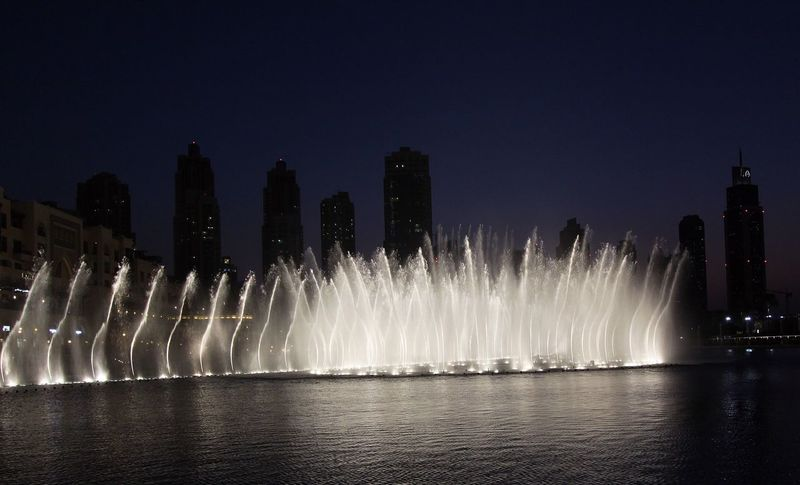 Dubai Architecture Arts Culture And Entertainment Building Exterior Built Structure Firework Display Illuminated Long Exposure Motion Night No People Outdoors Sky Spraying Tourism Travel Destinations Water Waterfall Waterfront