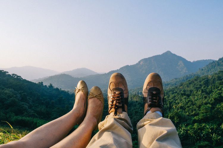 Beauty In Nature Clear Sky Day Friendship Human Leg Lifestyles Low Section Men Mountain Mountain Range Nature Outdoors People Real People Relaxation Scenics Shoe Sky Togetherness Tree Two People
