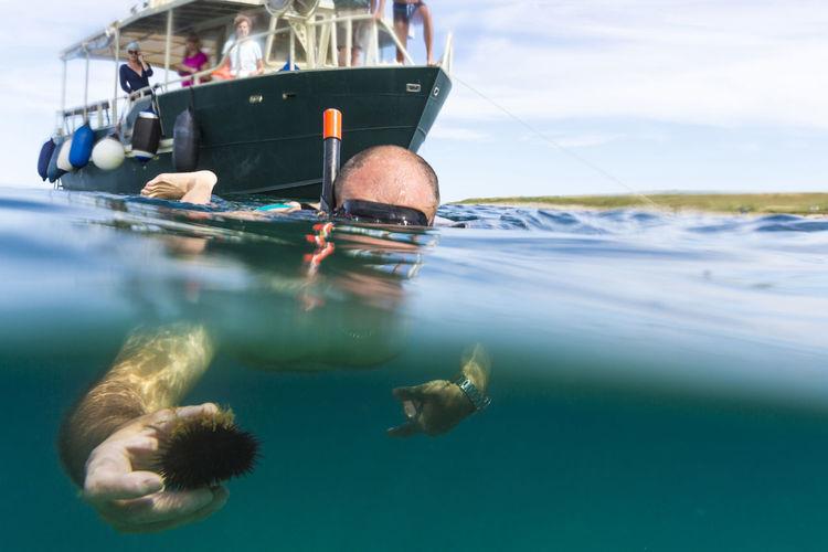 Man scuba diving in sea