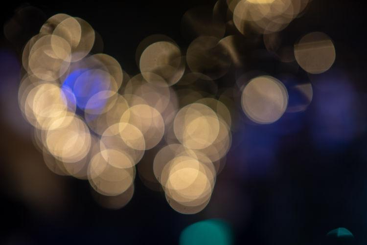 Illuminate Night Defocused Illuminated Circle Abstract Light Shape Geometric Shape Pattern No People Lens Flare Glowing Lighting Equipment Light - Natural Phenomenon Electric Light Multi Colored Backgrounds Light Effect Decoration Christmas Outdoors Electricity  Purple