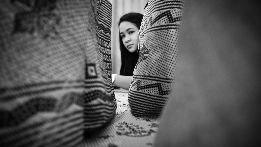 Among the rattan handbags Young Women Young Adult Person Confidence  Lifestyles Eye4photography  Black And White Photography Humaninterest Streetphotography