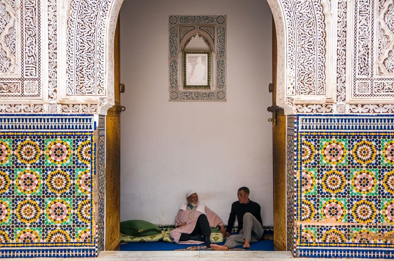 Inside a Mosque in Medina at Marrakesh. I love the colorful art and attention to detail, it's grest. Shot on the Sony Nex6 with the 1670z Sony lens. Post edited in Lightroom. Colours Two People Travel Destinations Smiling Peaceful Peace Colourful