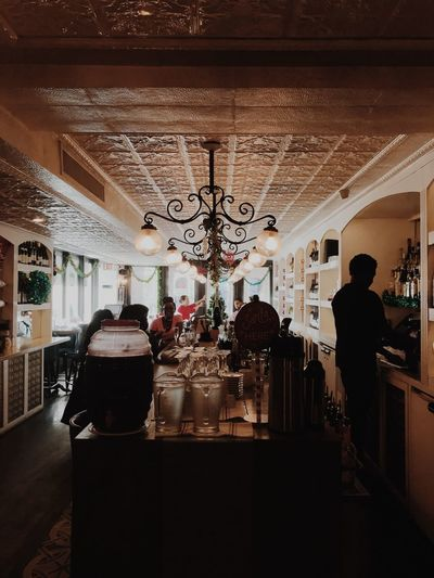 Restaurant Indoors  Group Of People Real People Architecture Men Built Structure Ceiling Incidental People Illuminated Lighting Equipment Glass - Material People Decoration Pattern Travel Day Silhouette Adult Lifestyles