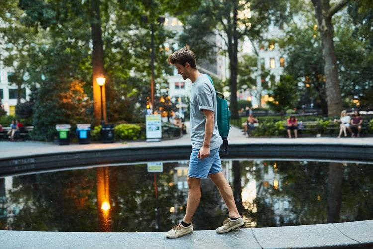 Full length of man walking in city