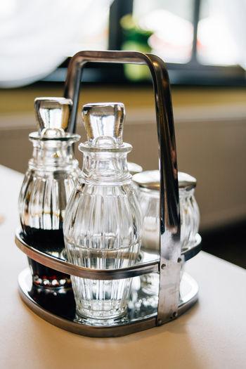 Close-up Dining Glass Restaurant Salt And Pepper Sauce Selective Focus Still Life