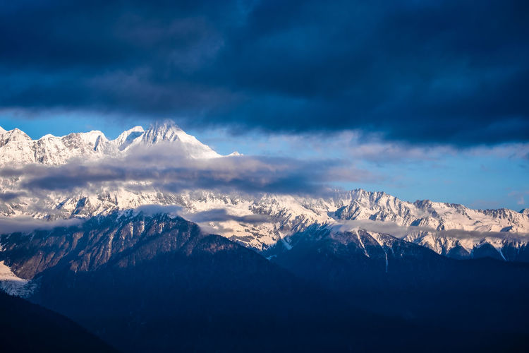 Beauty In Nature Scenics - Nature Mountain Cloud - Sky Snow Winter Sky Cold Temperature Snowcapped Mountain Tranquil Scene Mountain Range Tranquility Environment Non-urban Scene No People Nature Landscape Idyllic Mountain Peak Outdoors Formation Meili DeQin Yunnan China Tibet Top High Fog Cool Cold